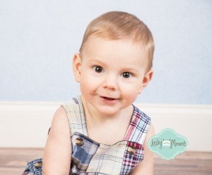 This adorable 6 month old. Had a blast giggling at this sweet 6 month old boy while taking his pictures.